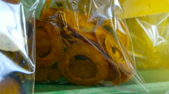 Serving of dried fruit in individual packages, fruit chips, slices, close-up Stock Footage
