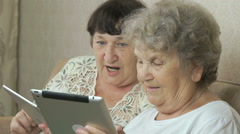 Women holding the silver digital tablets Stock Footage