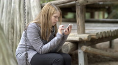 Young girl having fun playing game on cell phone 4k Stock Footage