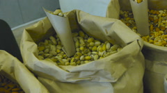 A bag of pistachios, market stall, nuts Stock Footage