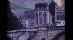 1969: a huge old stone church with mountains in the background view. PARIS Stock Footage