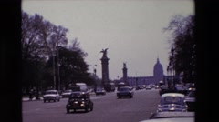 1969: cars and busses drive down a somewhat busy road PARIS, FRANCE Stock Footage