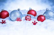 Christmas ornament in snow on glitter background Stock Photos