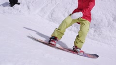 Ski resort. Snowboarder jump over stave. Instructor. Sunny day. Training Stock Footage
