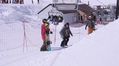 Ski resort. Trainer explain to snowboarders technique of make stunts. Sunny day Stock Footage