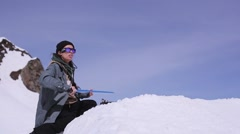 Ski resort. Trainer in sunglasses hold blue stave as springboard for snowboarder Stock Footage