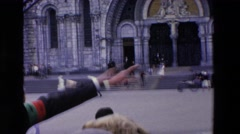 1969: a man giving directions to some passersby on a large square LOURDES Stock Footage