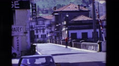 1969: watching two men walking in the european city LOURDES, FRANCE Stock Footage