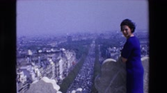 1969: a smiling woman in blue dress on a balcony overlooking city LOURDES Stock Footage