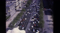1969: traffic congestion in major highway of city. LOURDES, FRANCE Stock Footage