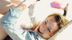 Happy careless girl sway in hammock on beach smile in camera. Sunny. Carefree Stock Footage