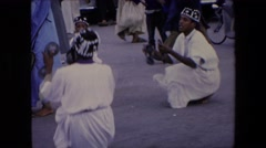1971: on a festival watching some people performing a ceremonial dance ALGERIA Stock Footage