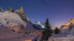 Sweeping day-to-night time lapse across a valley covered in virgin snow. Stock Footage