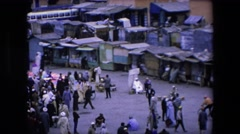 1971: hundreds of people milling about what looks to be an indian chantey town Stock Footage