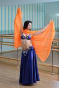 Beautiful woman dancing in arabic costume, oriental or belly dance Kuvituskuvat