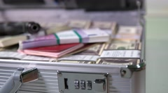 Case with money, passports and a gun Stock Footage
