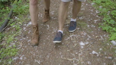 Closeup Of Couples Feet As They Walk Along Nature Trail (Slow Motion) Stock Footage