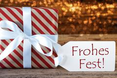 Atmospheric Gift With Label, Frohes Fest Means Merry Christmas Stock Photos