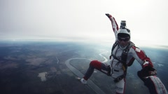 Skydivers freestyle in cloudy sky. Evening. Adrenaline. Open parachute. Sport Stock Footage