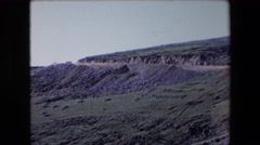 1971: view of a road in the desert curving downhill toward a canyon ALGERIA Stock Footage
