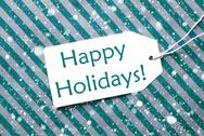Label On Turquoise Paper, Snowflakes, Text Happy Holidays Stock Photos