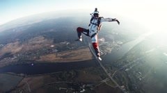 Skydivers freestyle in cloudy sky. Sunny evening. Adrenaline. Open parachute Stock Footage