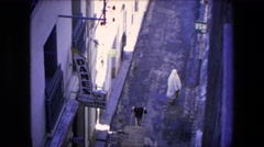 1971: woman wearing full body covering walking past dames sign zoom in on power Stock Footage