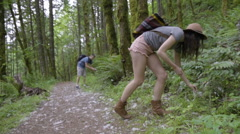 Couple Collect Large White Fuzzy Pollen From The Forest Floor Stock Footage