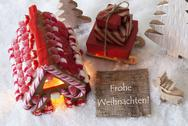 Gingerbread House, Sled, Snow, Frohe Weihnachten Means Merry Christmas Stock Photos