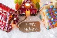Colorful Gingerbread House, Snowflakes, Text Happy Holidays Stock Photos