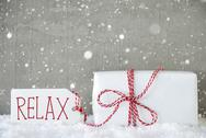 Gift, Cement Background With Snowflakes, Text Relax Stock Photos