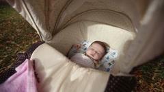 Sweet little baby sleeping in stroller Stock Footage
