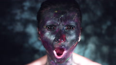 4k Cosmic Shot of a Woman with Alien make-up moving to Focus and Screaming Stock Footage
