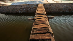 Wooden Bridge over Canal to Salt Heaps at Lakes in Vietnam Stock Footage