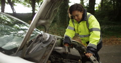 4k, Portrait of an attractive African American roadside female mechanic. Slow mo Stock Footage