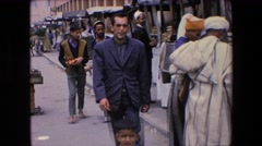 1971: many villagers in a middle eastern marketplace are walking, shopping Stock Footage