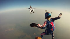 Skydivers freestyle in sky. Extreme sport. Adrenaline. Height. Flight. Clouds Stock Footage