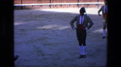 1971: a bull charging and attacking a bull fighter in costume SPAIN Stock Footage