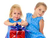 Two sisters with a gift Stock Photos