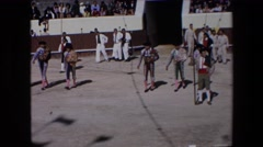 1971: matadors entering sandy bull fighting arena on sunny day in spain SPAIN Stock Footage
