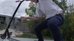 Scooter close up tailwhip big jump Stock Footage