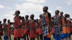 Group of maasai boys dancing at koiyaki guiding school graduation in kenya Stock Footage