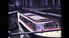1967: traveling people boat water thru city AMSTERDAM, NETHERLANDS Stock Footage