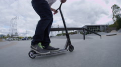 Scooter grind on rail in skatepark Stock Footage