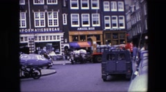 1967: a busy circa 1960s european street, possibly amsterdam, with draft horses Stock Footage