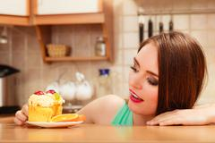 Woman eating delicious sweet cake. Gluttony. Stock Photos