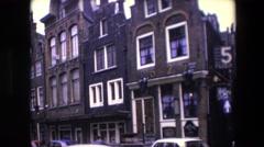 1967: five flies restaurant hanging building sign in neighborhood AMSTERDAM Stock Footage