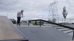 Slow motion scooter trick on rail - tailwhip extreme sport Stock Footage