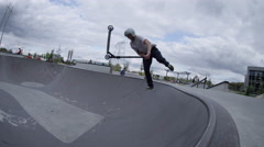 Slow motion scooter extreme trick on skatepark obstacle Stock Footage