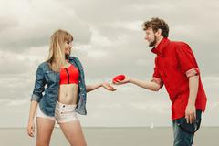 Couple in love holds red heart outdoor Stock Photos